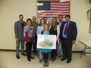 Keilholtz Memorial Award Winner-Eric and Vicky Troxell, L-R Rob McAfee (NRCS), Sharon and Jim Keilholtz (presenting award), Eric and Vicky Troxell and family, Hans Schmidt (MD Associate Secretary of Agriculture), Bobby Myers (Frederick SCD Supervisor)